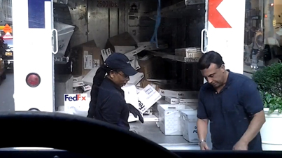 FedEx Worker Caught Recklessly Tossing Dozens of Packages Into A Truck