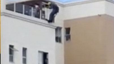 Man Kicked Back Into Window When Trying To Jump Off Building