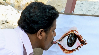 Indian Artist Creates Over 1,000 Paintings Using Just His Tongue