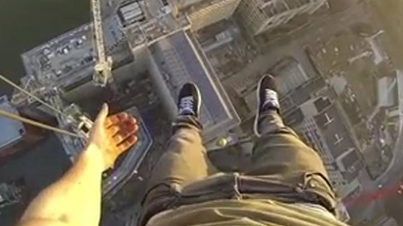Insane Daredevil Hangs From A Crane 500 Feet Up With Just One Hand