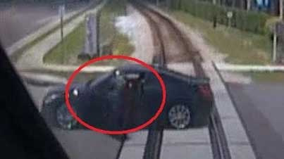 Caught On Film: Woman Escapes Being Crushed By A Train As Her Car Stalls On The Tracks