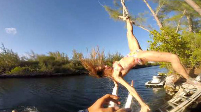 Ouch: Woman Gets Her Foot Stuck In A Rope Swing And Smashes Into A River Bank of Rocks