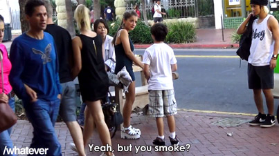 9-Year-Old Kid With A Cigarette Asks Strangers For A Lighter