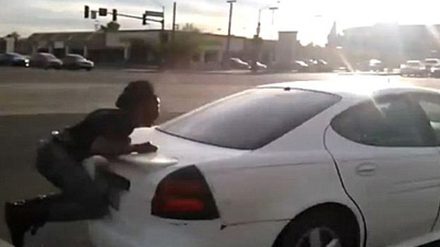 Well Damn: Man Clings For His Life While A Car Tries To Run Him Over