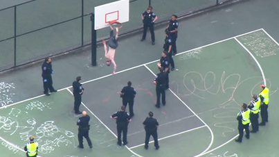 Crazy Shirtless Man Gets Stuck In A Basketball Hoop And Has To Be Rescued