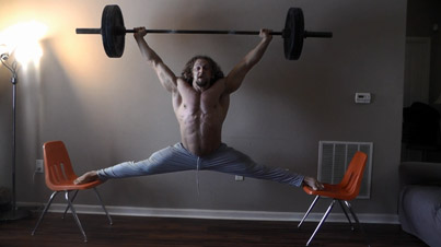 Get Fit Or Die Trying: Weightlifter Holds Up 100lbs While Doing Chair Splits