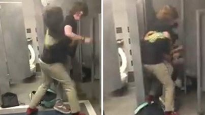 Bathroom Fight Interrupts Poor Kid Trying To Take A Dump