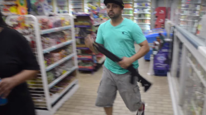 Ferguson Store Owners Strap Up And Defend Their Business From Looters