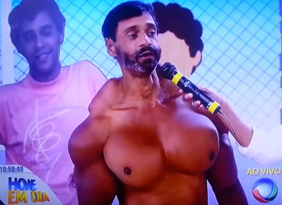 Douchebag Flexes His Brand New Synthol Filled D-Cup Breasts On TV