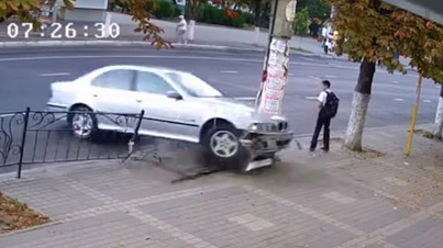 Lucky Kid Moves Out Of The Way Just Before A BMW Crashes Right Where He Was Standing