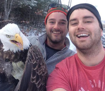 Brothers Take Epic Selfie After Rescuing Bald Eagle From Trap In Canada