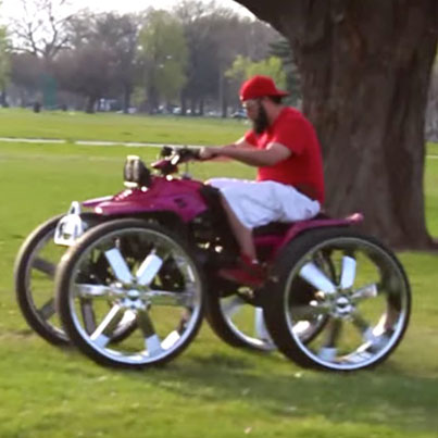 Meanwhile In The Ghetto: Man On A 4-Wheeler With 28 Inch Rims Doing Donuts