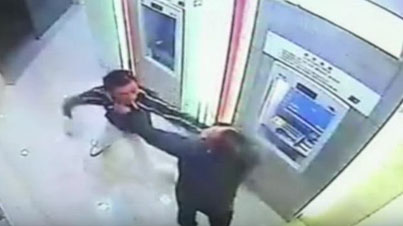 Sh*t Gets Real When A Robber Tries To Take Cash From A Dude At ATM