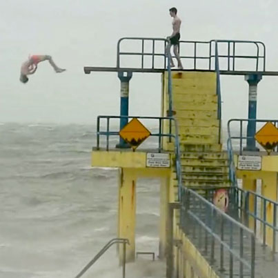 Two Morons Dive Into The Ocean During Huge Storm
