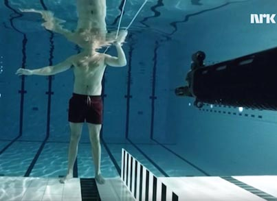 Daredevil Physicist Stands In Front Of A Loaded Gun Under Water