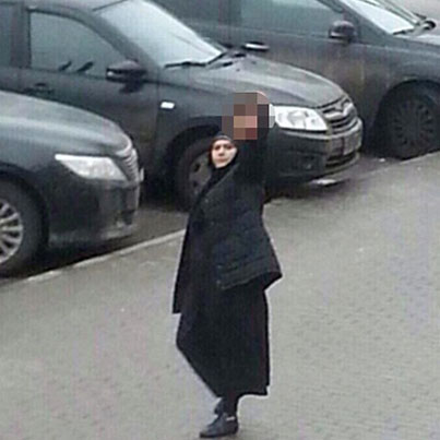 Woman In Burka Walks Streets Carrying Child's Severed Head