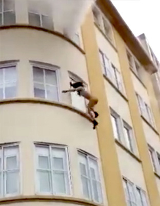 Half Naked Woman Jumps From A Burning Building