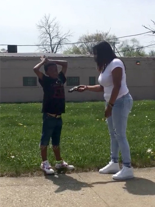 Woman Stops Random Kid On The Street To Confiscate Handgun