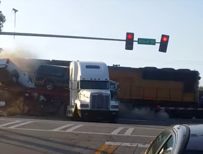 Truck Fully Loaded With Cars Gets Stuck On Train Tracks 😭