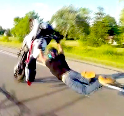 Massive Wheelie Crash Ends In A Severe Case Of Road Rash