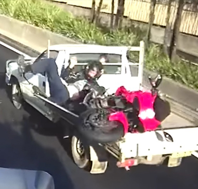 Motorbike Rider Not Paying Attention Lands In Pickup Bed