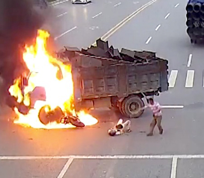 Motorcyclist Rescued From Flames After Crashing Into Truck In China 😱😱😱
