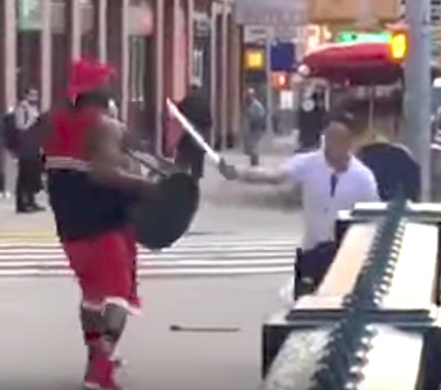 Two Men Have A Gladiator Style Battle On The Streets Of NYC
