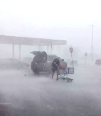 70-Year-Old Lady Battles A Hurricane To Return Her Shopping Cart 😱🌪