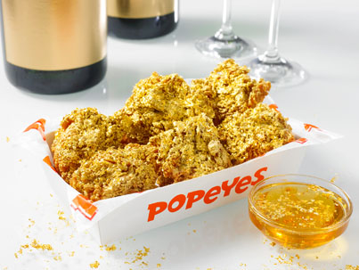 Popeyes Is Selling 24-Karat Gold Wings Dipped In Champagne For $5 ✨🤑🍗