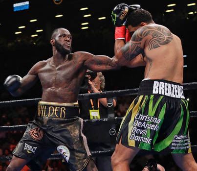 Deontay Wilder KOs Breazeale In The First Round 😱😱😱