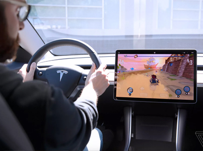 New Tesla Has A Racing Game That Uses Cars Actual Steering Wheel & Brakes 🔥👀🔴👑